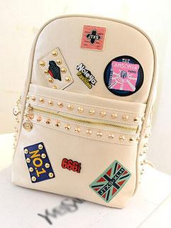 Fashion Rivets Emblem Appliques Front Zip Wholesale Backpack