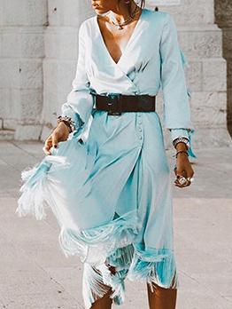 Stylish Irregular Solid Tassels Long Sleeve Dress