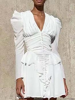 Boutique Ruffled Hem Ruched Long Sleeve Dress